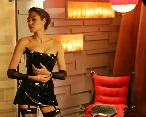 Angelina Jolie dons a dominatrix outfit in the film Mr. and Mrs. Smith. Jolie's character is a suburban housewife doubling as a secret assassin. The hyper sexualized side of Mrs. Smith seems so unnecessary. This movie is just another example of using...