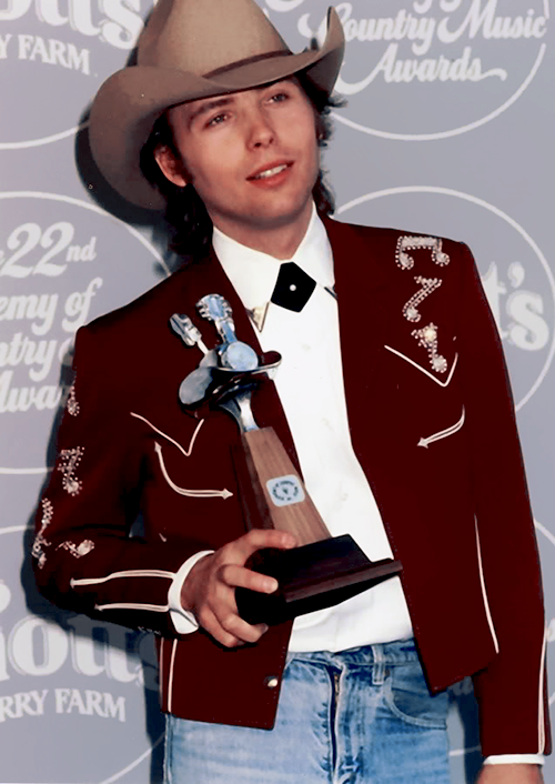 fuckyeahdwightyoakam:  Dwight Yoakam with his award, 1980s.  Dwight Yoakam is a bit older now but he's still award-winning and an  awesome country rocker! See him live when he comes to Jannus Live on Tuesday, June 11th! 7PM. Get tickets here!
