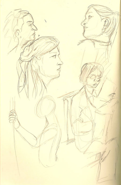 Finally, my scanner works! Some sketches I did while riding the Metro the other week. The headless one was a rider who got off before I could get her face on paper.