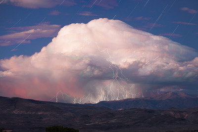 asaya:  Star Trails Over Twilight Thunderstorm (by Jeffrey Sullivan)