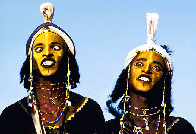The Gerewol Festival The Wodaabe are a nomadic people populating the Sahel desert of West Africa. Once a year in a few secret locations, their tribe gathers to celebrate the fantastic tradition of Gerewol, often referred to in the popular press as a male beauty pageant. Overall, this festival is a male beauty contest between clans. The elders select some women for their own beauty, they will select the best looking men and take them to the bush. Folded on their heads are the blankets they will use to rest in pairs. See how they dance and make their choice here Picture by Victor Englebert