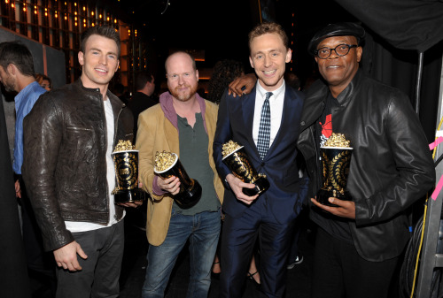 torrilla:  Chris Evans, Joss Whedon, Tom Hiddleston winners of the award for best fight for 'The Avengers' pose with winner of the award for best WTF moment for 'Django Unchained' backstage at the MTV Movie Awards in Sony Pictures Studio Lot in Culver City, Calif., on Sunday April 14, 2013 [HQ]