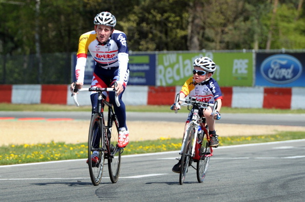 Jurgen Van Den Broeck rides next to his cousin Lars Van Den Broeck during a fan day of Lotto Belisol.