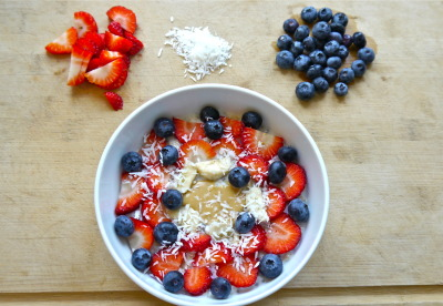 dontjustsurvive-live:  Banana oats with strawberries, blueberries, mixed seeds, coconut and peanut butter - the america flag :)