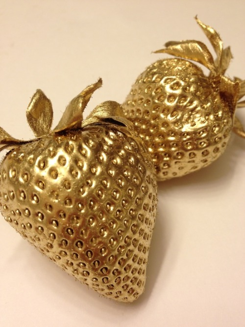circumcised:  Gold spray painted strawberries