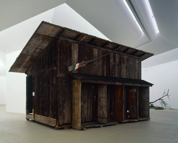 Simon StarlingShedboatshed (Mobile Architecture no. 2), 2005 At first sight, Simon Starling's Shedboatshed (Mobile Architecture no. 2) appears to be a readymade. It's an old shed. It looks a bit the worse for wear, but age will do that to a shed. Things aren't quite a simple as they appear though and the first clue's in the title. Shedboatshed is a shed. Shedboatshed started out as a shed. But it hasn't always been a shed. Starling turned an old shed, which he'd found in the banks of the Rhine, into a boat which he then used to get to Basel, carrying the unused parts of the shed in the boat. On arrival, the shed was reassembled and exhibited in the Kunstmuseum Basel and later that year in Tate Britain as part of the Turner Prize exhibition, which Starling won.