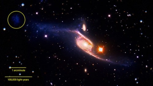 Astronomers have long known that a spectacular barred spiral galaxy named NGC 6872 is a behemoth, but by compiling data from several space- and ground-based observatories and running a few computer simulations, they have now determined this is the largest spiral galaxy we know of. This composite of the giant barred spiral galaxy NGC 6872 combines visible light images from the European Southern Observatory's Very Large Telescope with far-ultraviolet data from NASA's GALEX and 3.6-micron infrared data acquired by NASA's Spitzer Space Telescope. Credit: NASA's Goddard Space Flight Center/ESO/JPL-Caltech/DSS  Read more