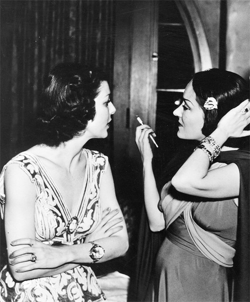 trixiedelight:  Loretta Young and Gloria Swanson at the Screen Actor's Guild Ball, 1935