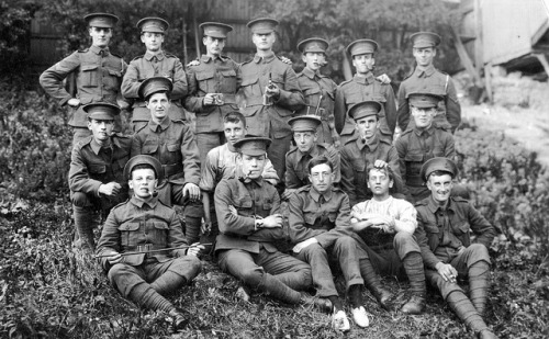 davidcorvine:  Young British soldiers of World War One - The 21st Battalion,  London Regiment (1st Surrey Rifles) - Note, front row 2nd from left is George Henry Kemp ( sitting, arms crossed & pipe in mouth ) by DesertBlooms on Flickr.