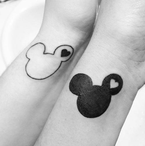 disneyink:  My Disney tattoo. My best friend and I got matching ones. I'm on the left while she's on the right. We are often described as Yin and Yang and we both love Disney to death, so naturally we would get something like this. Its my first tattoo and I couldn't ask for a better one(: It was done at Blue Moon Tattoo and Piercings in Tracy, CA