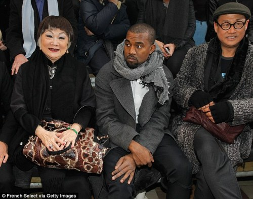 Celebrity Scarf Watch: Kanye West wearing a grey marl scarf at the Lanvin show at Paris Fashion Week.