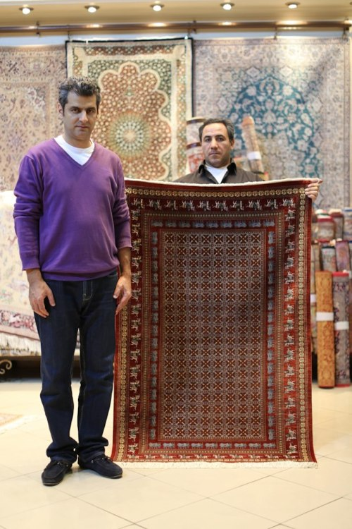 "humansofnewyork:  Going to a carpet shop in Iran is like going to an art gallery. (In this case, I visited the Iran Carpet House on Dr. Fatemi Street). The first carpet was made 2,500 years ago in Ancient Iran. And the tradition has developed into one of the world's finest arts. The carpets are respectfully referred to as ""pieces,"" and the finest ones bear the signature of the artist. Some carpets take a single artist several years to weave. The carpets are divided into two main groups: Nomadic and City. The Nomadic carpets are made by mountainous nomadic tribesmen, contain mostly wool, and are woven completely from the imagination of the artist. Therefore, ""there is no such thing as a mistake in a Nomadic carpet."" City carpets are more expensive, because they contain large amounts of silk, and are painstakingly rendered from preset patterns. The ""holy grail"" of Persian carpets is the rare nomadic carpet made of silk, not wool. (Ideally imbued with magic flying powers)"
