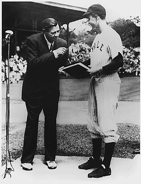 ourpresidents:  Babe Ruth and George Bush On January 29, 1936, the Baseball Hall of Fame elected its first members. Among the five men was Babe Ruth, seen in this photograph taken in 1948, donating the manuscript of his autobiography to Yale. The young man in uniform is the captain of the Yale baseball team and a future President. George H. W. Bush was an older college student—he had delayed going to college and joined the Navy after the attack on Pearl Harbor.  More: Baseball Photos of George Bush