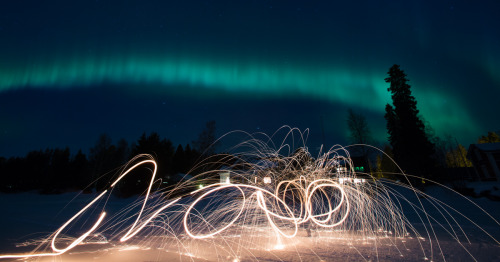 photosfromnorth:  Spinning steel wool during Aurora Borealis. Haukipudas, Finland — March 2013