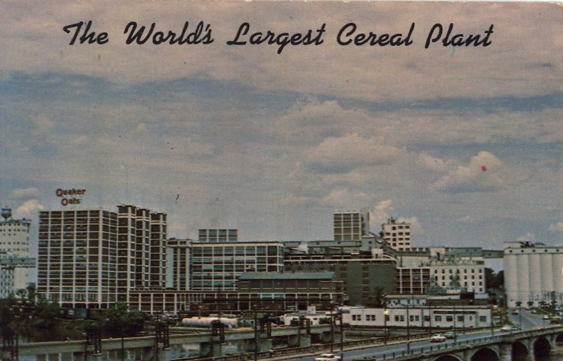 "THE WORLD'S LARGEST CEREAL PLANT    QUAKER OATS COMPANYCedar Rapids, Iowa This famous plant occupies some 20 buildings and covers an area of 15 acres and is the world's largest cereal plant. The capacity of the seven towering Grain Elevators is nearly 10,000,000 bushels. This is one of the outstanding sights in Cedar Rapids which is known as ""The Cereal Capital of the World.""    Makes one hungrier for Kooky Krunchy Choco Sugar Puffs."