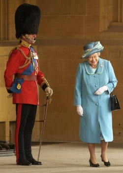 Queen Elizabeth laughing at Prince Phillip in uniform