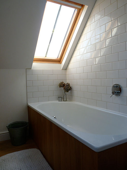 bath under the window (via Sneak Peek: Victoria Suffield and Phil Webb | Design*Sponge)