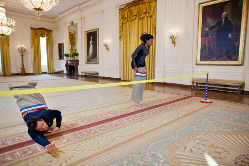 abject-perversity:  First Lady Michelle Obama participating in a potato sack race with Jimmy Fallon in the East Room of the White House.