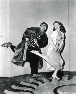 Rita Hayworth and Charles Laughton fooling around between the takes of Salome (1952)