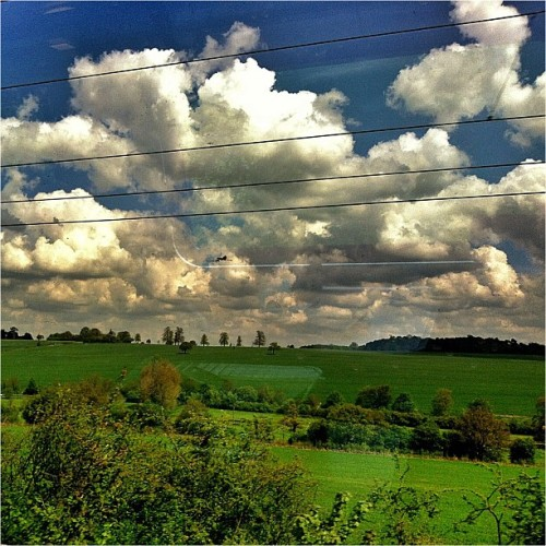 Through the train's window #london #luton #window #train #railway #bluesky #sky #clouds  (at Luton Airport Parkway Railway Station (LTN))