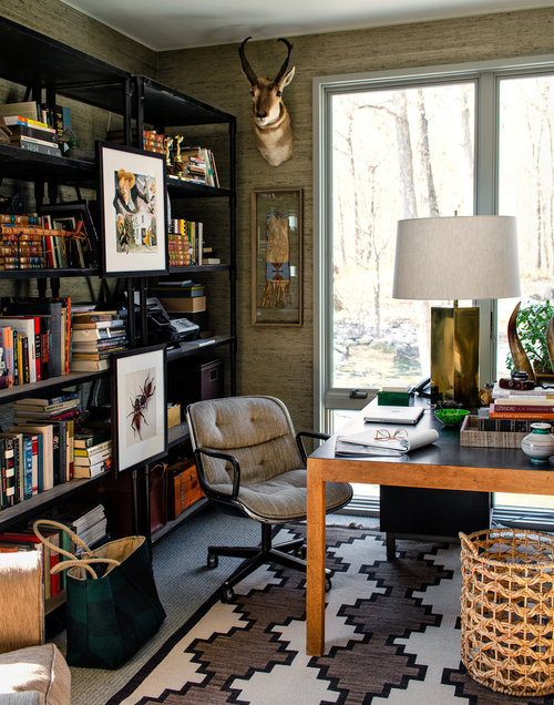 "minimaldesks:  Workspace of Jay Fielden, editor in chief of Town & Country magazine. His family had to rebuilt their mid-century modern home after it was destroyed by fire.  Jesse Carrier described Mr. Fielden as ""a frustrated set designer."" He went on: ""When you look at his office, it's like a backdrop for Ernest Hemingway."" Mr. Fielden found the antelope head at a local antiques store. The parsons desk was bought with the house, and survived the fire. The rug is new,  from Ralph Lauren Home."