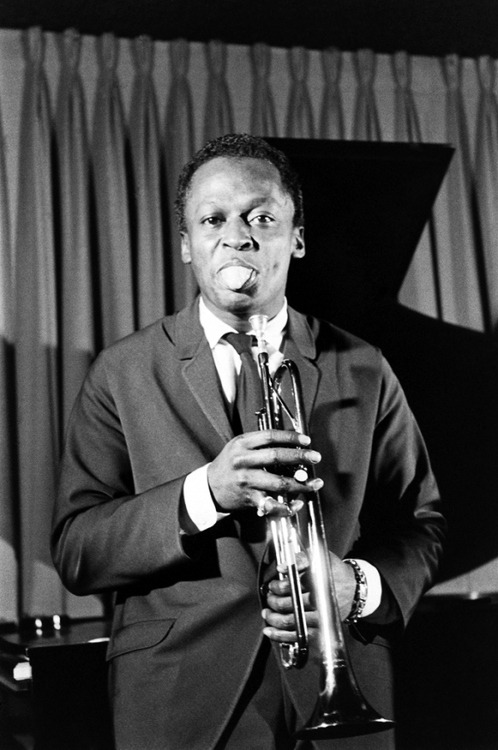 "Today's cool Miles Davis photo demonstrates that Miles — the man who consistently delivered the best ""motherfucker"" in jazz history — had a goofy side.  Don't forget to check out GOING MILES! (http://www.alangoldsher.com/Going_Miles/Going_Miles.html)"