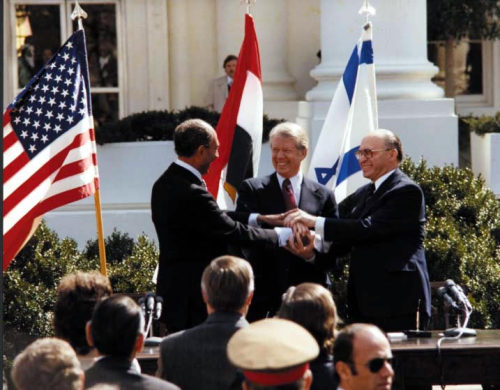 "ourpresidents:  Peace Treaty Between Egypt and Israel Today in history, Presidents Jimmy Carter and Anwar Sadat, and Prime Minister Menachem Begin joined hands in celebration of the signing of the ""Treaty of Peace Between the Arab Republic of Egypt and the State of Israel."" North Grounds of the White House, March 26, 1979.  This is among the most requested photographs in the holdings of the Carter Library. More - Historic Materials on the Camp David Accords"