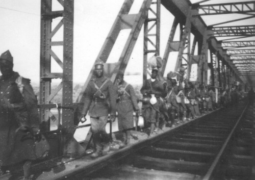 Colonial French POWs walking in columns, June 1940