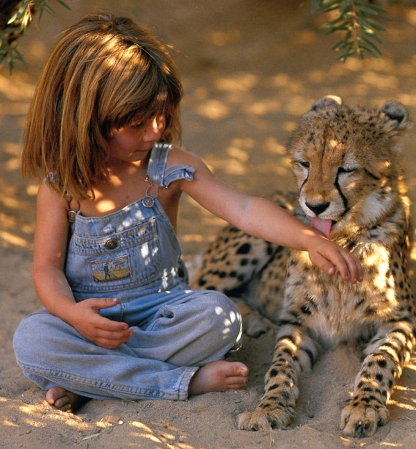 ashleymater:  Tippi Benjamine Okanti Degré, daughter of French wildlife photographers Alain Degré and Sylvie Robert, was born in Namibia. During her childhood she befriended many wild animals, including a 28-year old elephant called Abu and a leopard nicknamed J&B. She was embraced by the Bushmen and the Himba tribespeople of the Kalahari, who taught her how to survive on roots and berries, as well as how to speak their language. Learn more