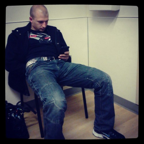My honey on his new phone sticking it out here at the emergency room with me. :) (at Providence Regional Medical Center Emergency Room)