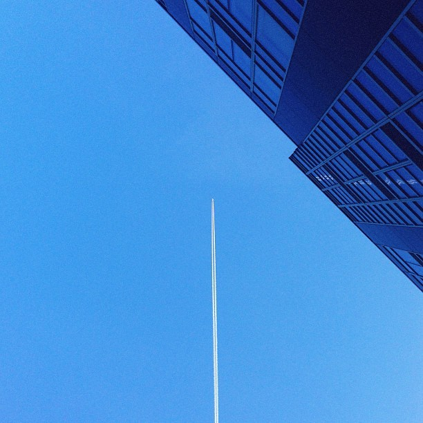 Contrails and condos (via claytoncubitt on Instagram)