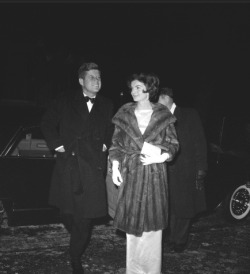 odetojohn:  President John F. Kennedy and wife Jackie stand outside the home of Congressman John Sherman Cooper (R-Ky) where they will dine. (Washington, DC; Jan 28, 1961) (Photo Bettmann/CORBIS) Nice coat!