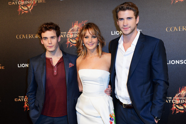 Sam Claflin, Jennifer Lawrence & Liam Hemsworth attend The Hunger Games: Catching Fire Party during the 66th Annual Cannes Film Festival at Baoli Beach in Cannes, France. [May 18th, 2013]