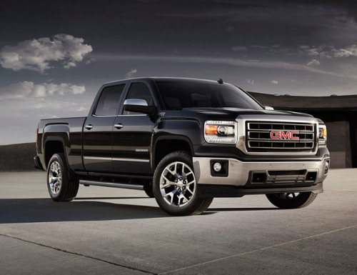 The 2014 GMC Sierra & Chevrolet Silverado. Refined brutes — and we love them for it.