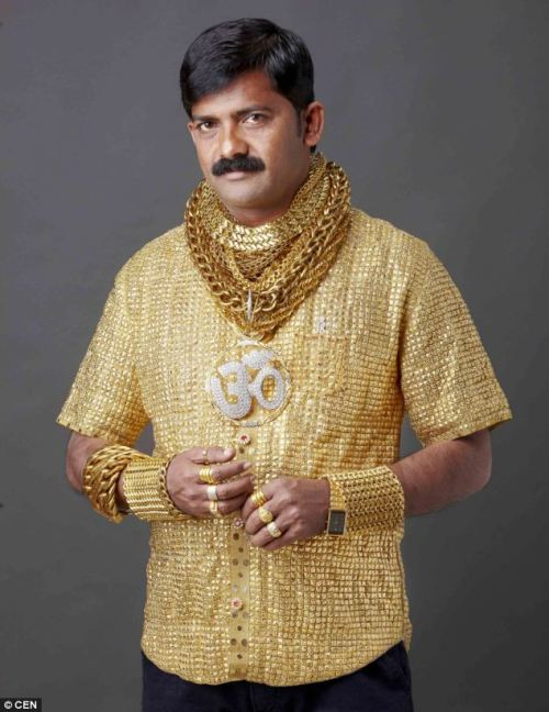 Indian man spent £14,000 on a solid gold shirt in the hope it will attract female attention.