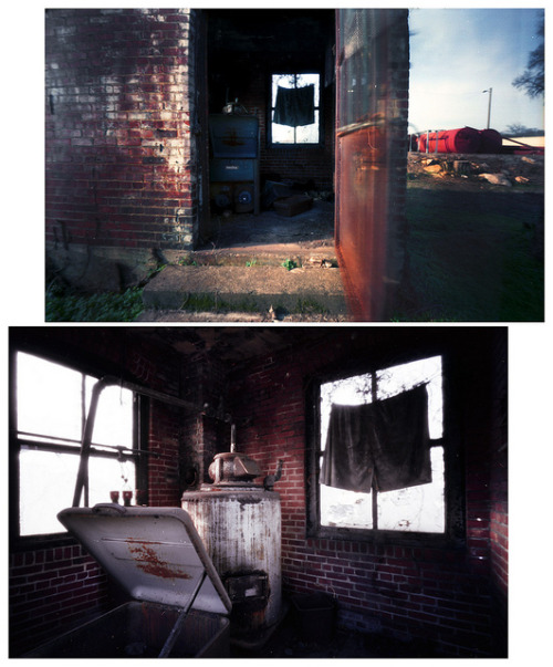 "Pinhole: Coal Room on Flickr.I think I prefer my phone image of this weird little standalone room/building. I call it ""Coal Room"" because the bin in the lower left of the bottom image was full of coal. And no"" it's not ""boxer shorts"" over the window, just some oddly cut fabric.  Zero Image 69, Kodak Portra 160, top image about five seconds, bottom image about 45 seconds"