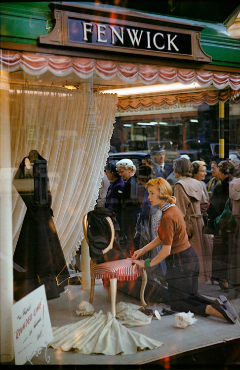 theniftyfifties:  A girl dressing a shop window in London, 1954. Photo by Inge Morath.