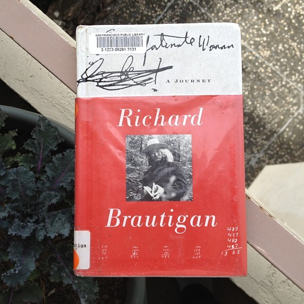 Currently reading: An Unfortunate Woman by Richard Brautigan (at Adams Point, Oakland)