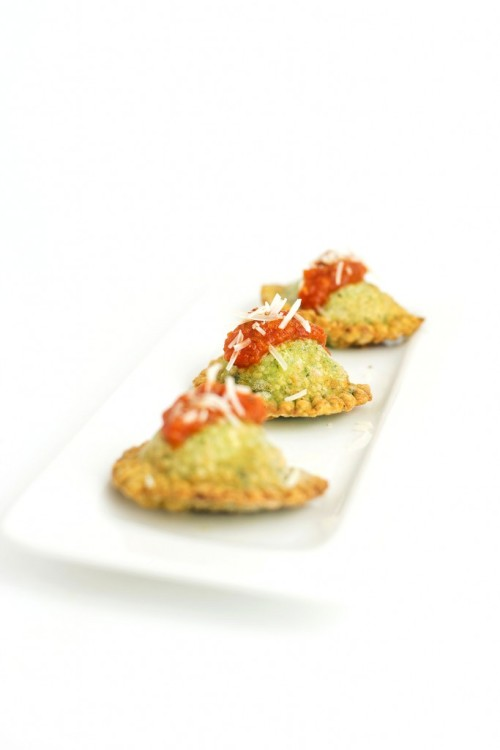 in-my-mouth:  Deep Fried Spinach Ravioli with a Spicy Tomato Sauce