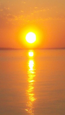 bridgetann1:  Orangy skies over the potomac…you can see the coastline of Virginia in the distance.