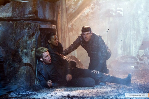 Spock is just doing his duty protecting his Captain. And if you give him a few moments, I'm sure he could give you numerous reasons why he needs to be touching gripping him that way.