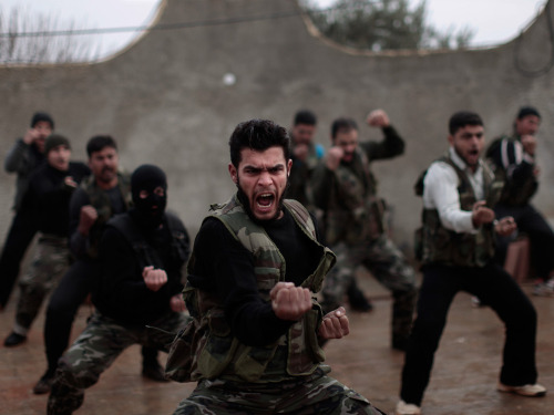 Wednesday's Guardian eyewitness: Syrian rebels at a training session near Idlib, in the north-west. The training is part of an attempt to transform ragtag rebel groups into a disciplined fighting force Muhammed Muheisen