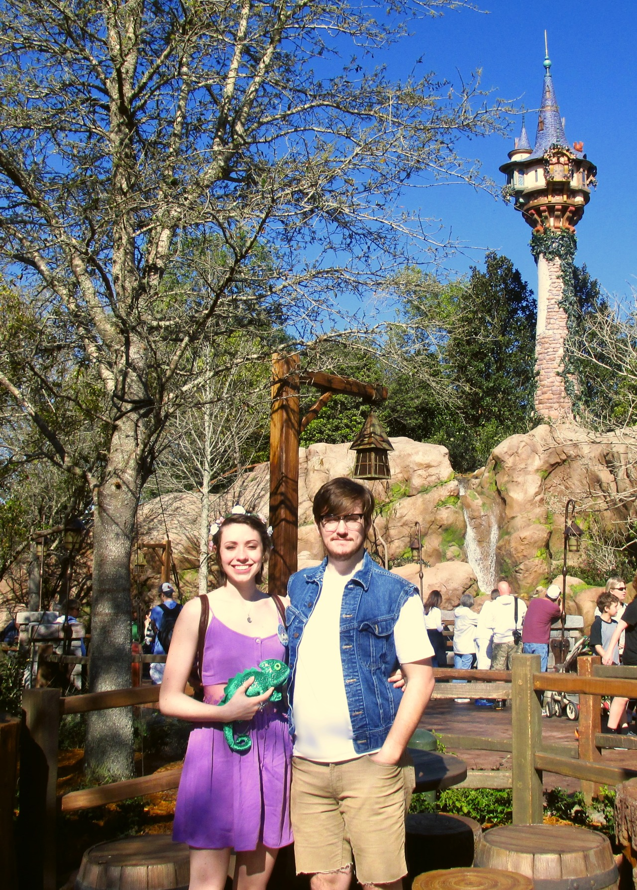 thefox-andthehound:  Austin and I as Rapunzel (post haircut) and Eugene, with Pascal, in front of the tower!