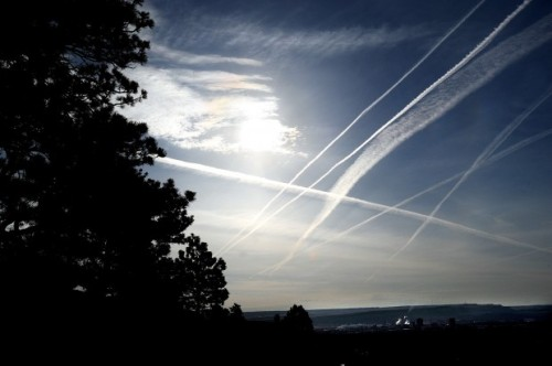 Contrails from passing jets fill the sky over Billings on Thursday.