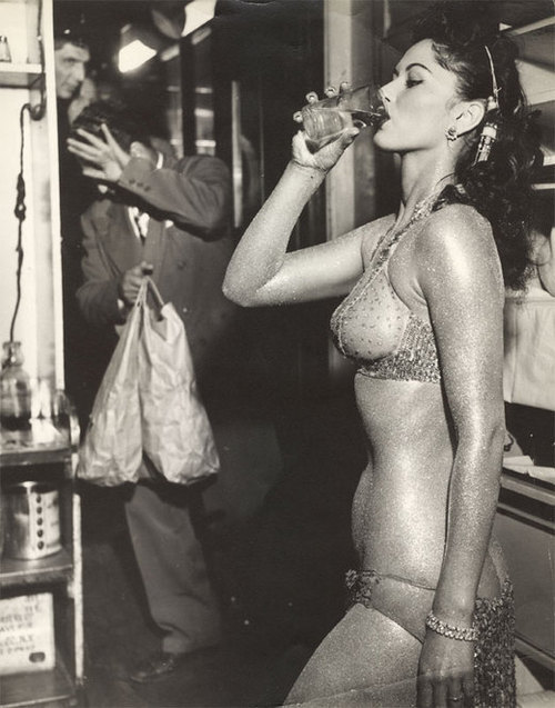 vintagechampagnefever:  A showgirl takes a drink in between performances