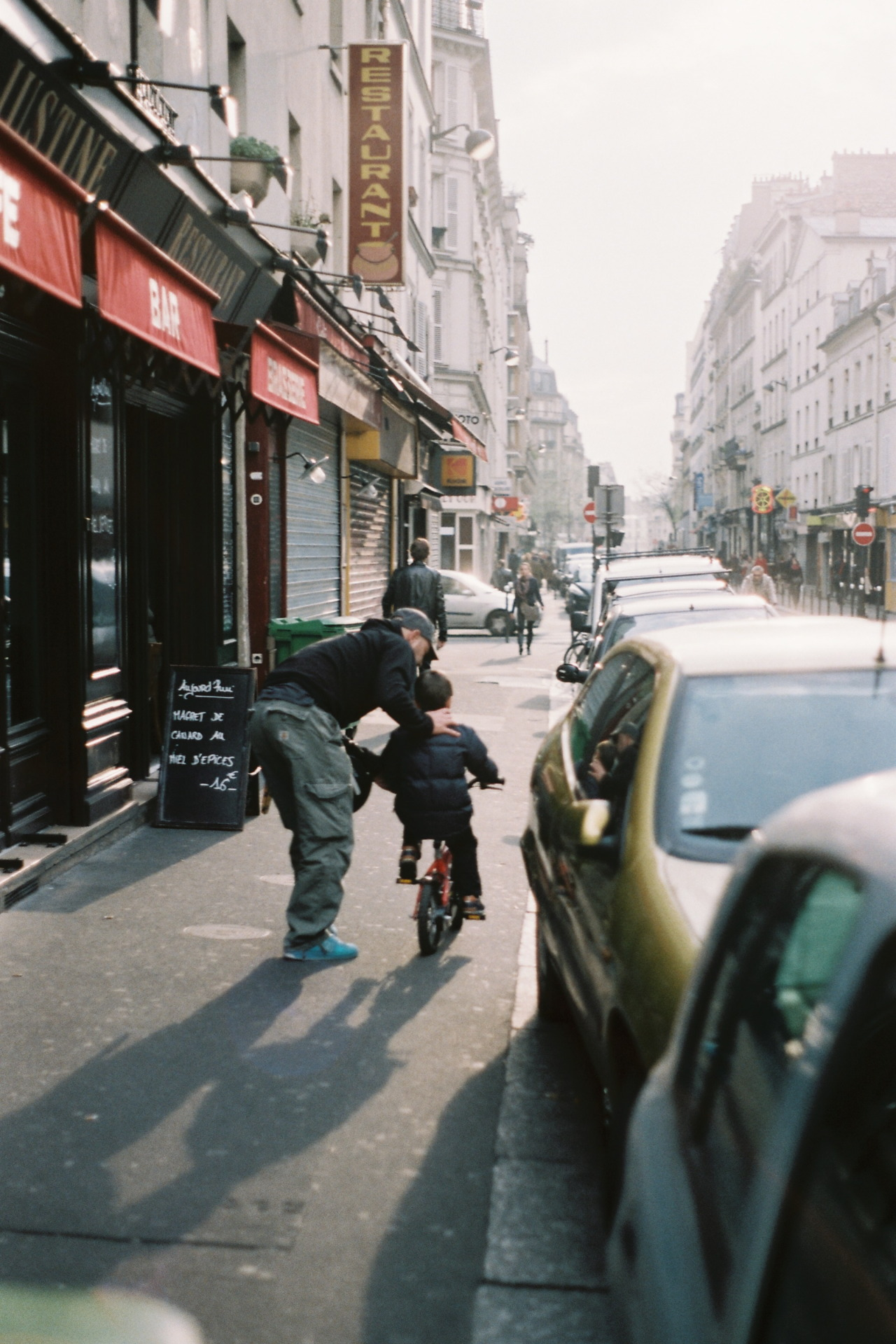 Learning to ride a bike on Rue Oberkampf. Paris, March 2011