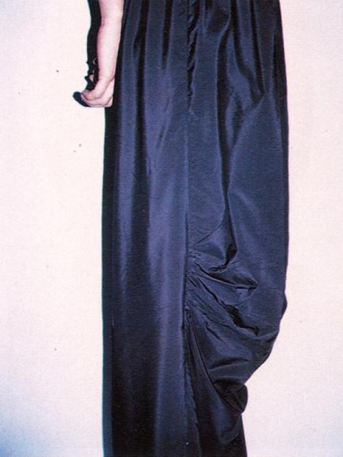 "vroomheid:  Maison Martin Margiela spring 1998  Metamorphosis The collection explored the transformation of a two-dimensional garment which becomes three-dimensional on the human body. During the presentation, while men in white lab-coats held up the clothes on hanger, the video was projected on five towers covered with white cotton cloth. Ten items from the collection were presented through 10 film sequences of 1 minute each. It showed images of women – neck-down – wearing the clothes, preceded by text descriptions like: ""the shoulder line of these garments has been brought totally forward onto their front.""  photographed by mark borthwick"