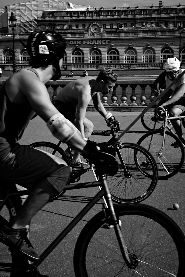 Parisian Bike Polo That's right… a bunch of sweaty dudes on bikes roughing each other up playing polo in Paris. Come and get it ladies… Photo By: Timothy O'Malley