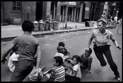 collectivehistory:  A policewoman plays with local kids in Harlem, NYC, 1978 by Leonard Freed.