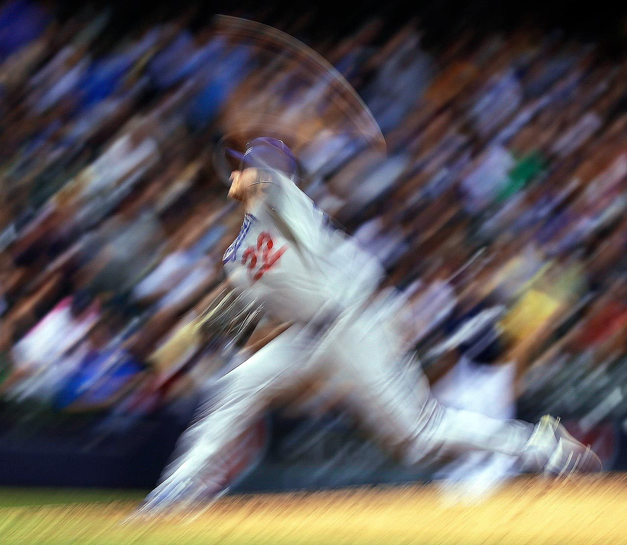 sportingnewsarchive:  JUST A BLUR Los Angeles Dodgers starting pitcher Clayton Kershaw throws during the sixth inning of a baseball game against the Milwaukee Brewers Monday, May 20, 2013, in Milwaukee. (AP Photo/Morry Gash)